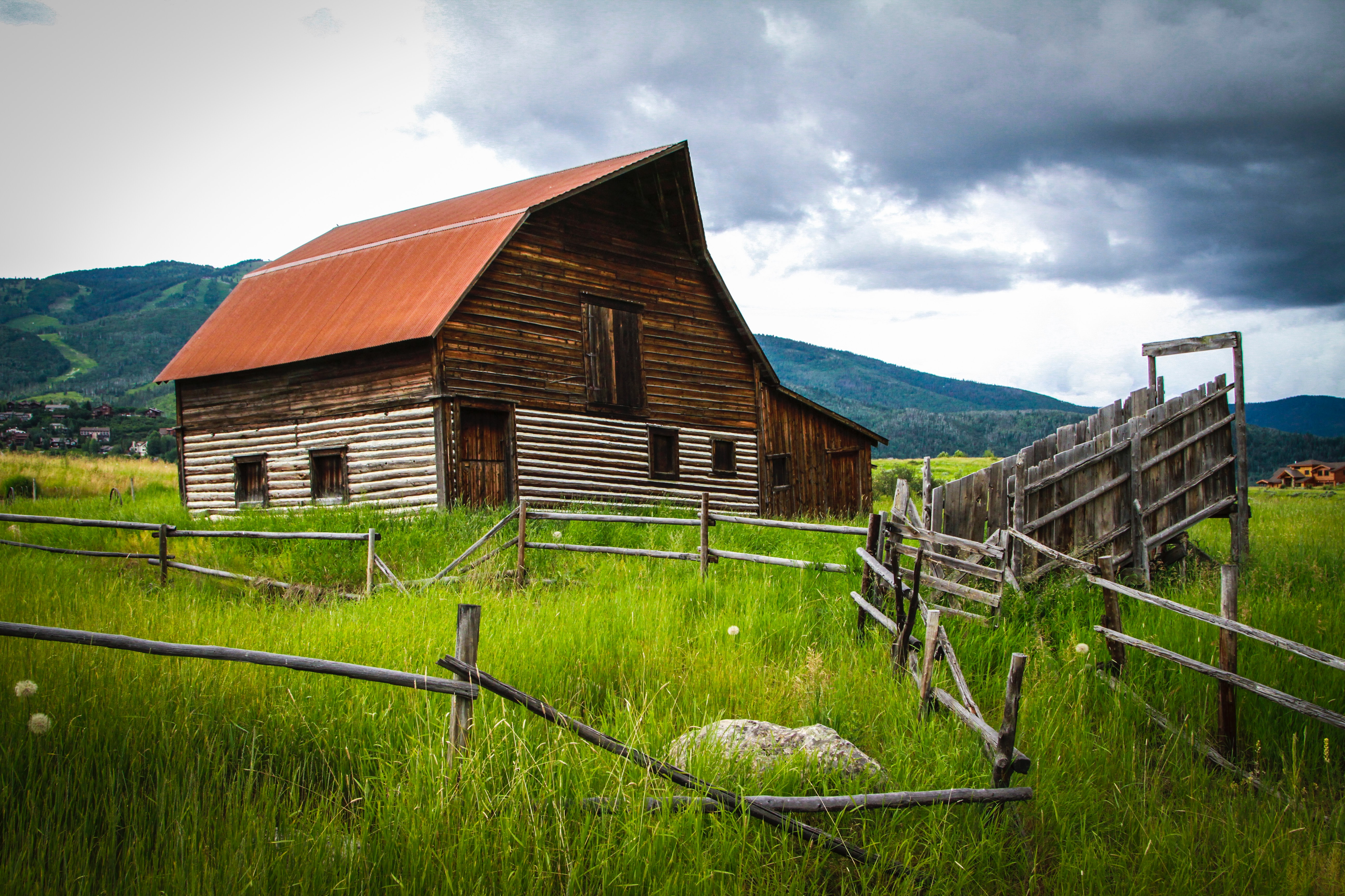 Picture of a barn surrounded by old wooden fences