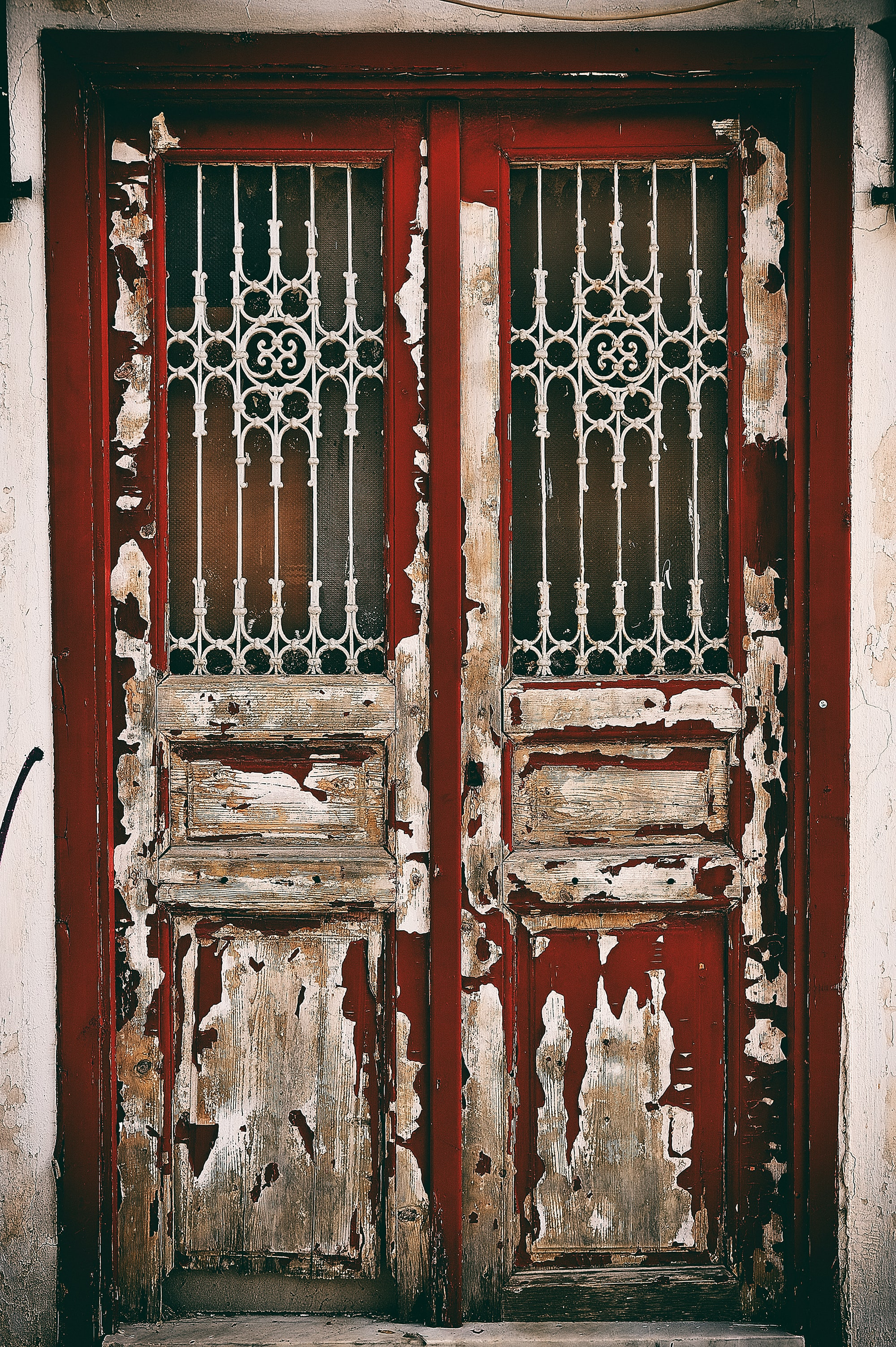 Picture of an old door with cracked and peeling paint
