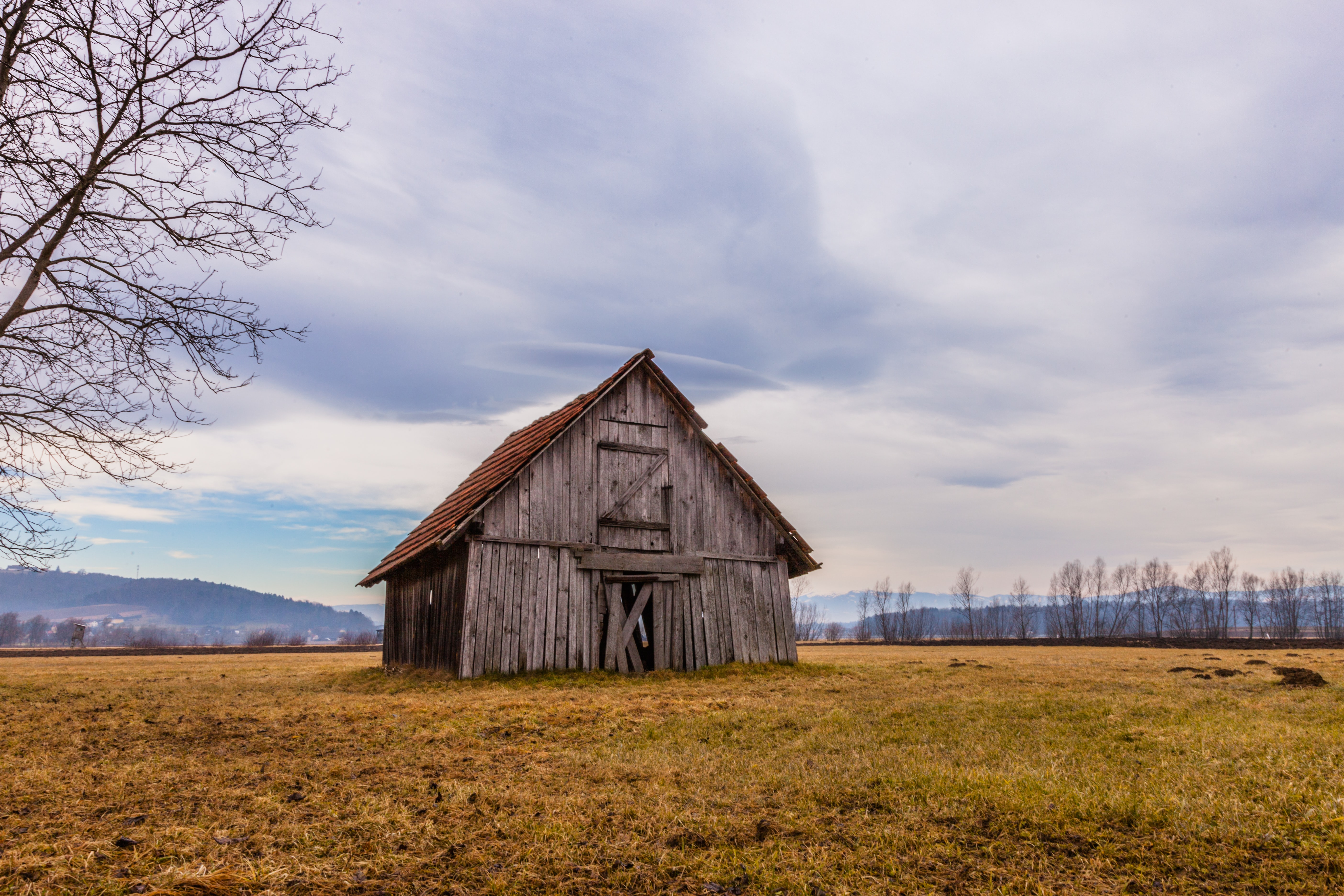 Picture of a wooden barn in a field