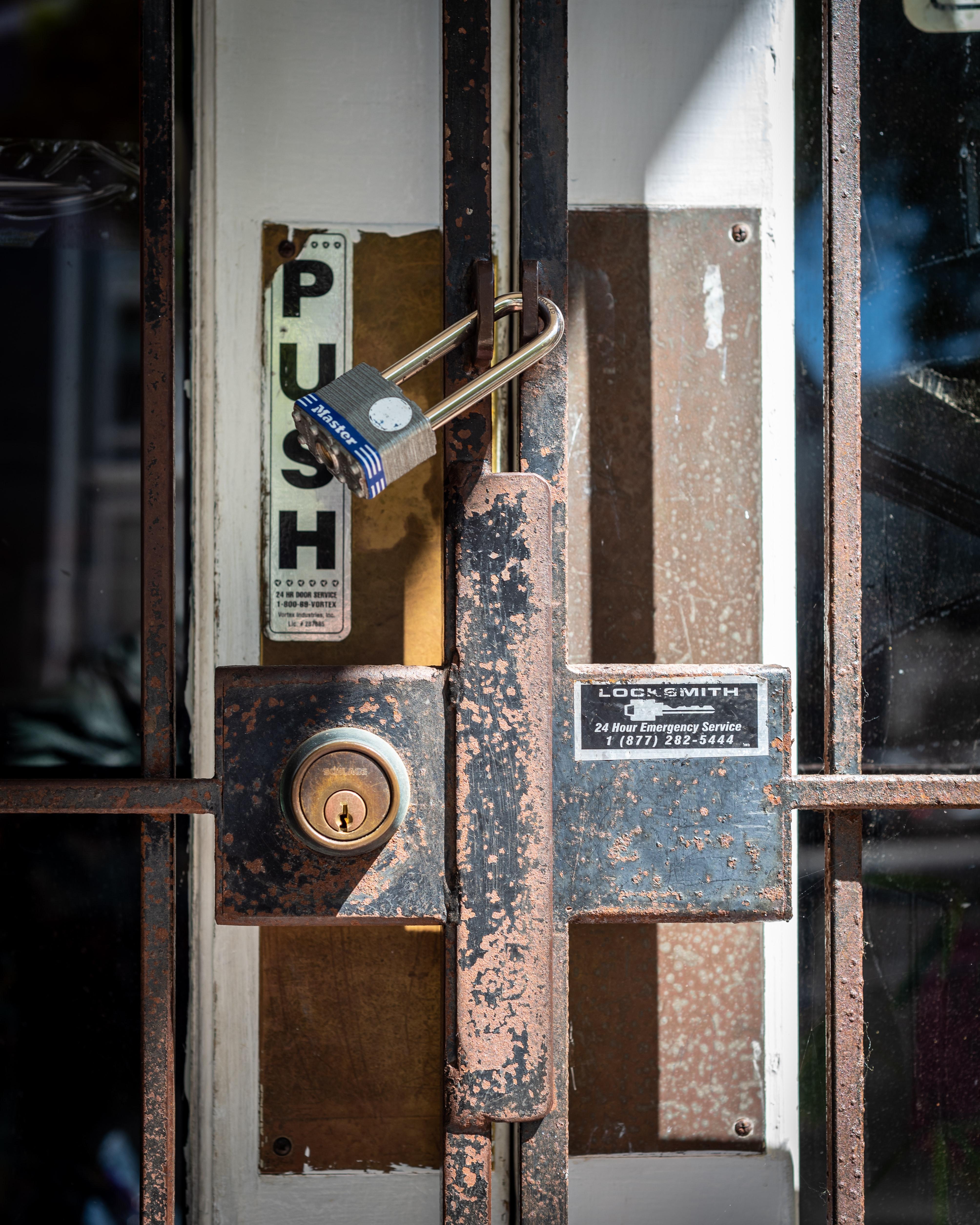 Picture of locks on an old rusty metal door